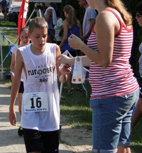 While Run Posey 2012 had 334 registered, only 264 braved the extreme heat and ran or walked the four miles around the lake. They raised over $5,000.00 for the Juvenile Diabetes Research Foundation. Ed Altwies won the Men's Overall in 21:43:30 and Sarah Mallow beat her own course record, even in the heat, with a time of 27:17:15. The Posey Lake neighbors really came out to help make sure there were plenty of water stations and braved the conditions themselves, standing in the sun spraying down runners with hoses and sprinklers. Hudson area sponsors included C.R.Motors, Ten Pin Pizza and Bowling, The Hudson Cinema Plaza, The Market House, Pest Patrol, and Friendly Fences. Our primary sponsors are Devil's Lake Water Sports and Running with E's.
